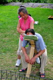 NYC: Woman Giving Massage in Central Park Stock Photo