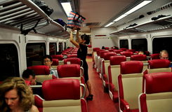 NYC: Woman in Metro-North Railway Carriage Royalty Free Stock Images