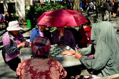 NYC: Woman Playing Cards in Chinatown Royalty Free Stock Photo