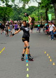 NYC: Woman Rollerblading in Central Park Stock Images