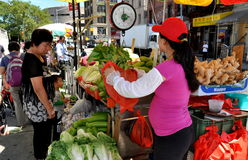 NYC: Woman Selling Produce in Chinatown Royalty Free Stock Image