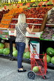 NYC: Woman Shopping for Fresh Fruit Royalty Free Stock Photo