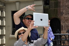 NYC: Woman Taking Photo with Ipad Royalty Free Stock Image