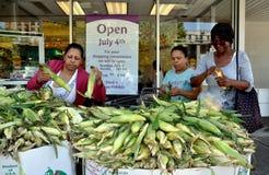 NYC: Women Buying Corn at Supermarket Stock Image