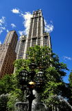 NYC: The Woolworth Building & Victorian Fountain. The Victorian Fountain in City Hall Park and the Woolworth Building, completed in 1913 at 233 Broadway, one Stock Photography