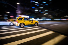 NYC Yellow Cab passing Fast at Night in Manhattan, New York. Royalty Free Stock Image