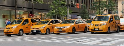 NYC Yellow Taxi. A line of NYC yellow taxi standing at the traffic light waiting for the light to change Stock Image