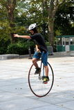 NYC: Young Man Riding a Unicycle. Young man riding a unicycle with a very large spoked wheel in the plaza in front of Grant's Tomb National Memorial during the Stock Image