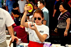 NYC: Young Woman Making an Egg Cream Royalty Free Stock Photos