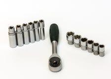 Nyckel- spärrhjul och en uppsättning av korta och långa signalljushuvud Royaltyfria Bilder