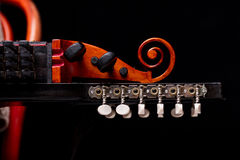 Nyckelharpa`s scroll, headstock and pegbox details. Concept of folk, baroque and classical music played with handcrafted ancient string musical instruments Royalty Free Stock Photos