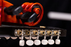 Nyckelharpa`s scroll, headstock and pegbox details. Concept of folk, baroque and classical music played with handcrafted ancient string musical instruments Royalty Free Stock Images