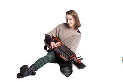 Nyckelharpor woman isolated on white. Woman with medieval or baroque musical instrument isolated on white; concept of folk music player Stock Photos