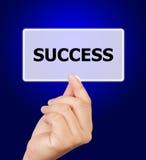 Nyckelord för framgång för knapp för manhand rörande. Royaltyfri Fotografi