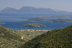 Nydri Bay, Lefkada. Small islands in the bay near town Nydri in Greek island of Lefkada (Lefkas). There are famous islands Madouri or Scorpios which is privat Royalty Free Stock Photo