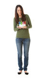 NYE: Γυναίκα που εξετάζει κάτω το κέικ γενεθλίων του 2015 Στοκ εικόνα με δικαίωμα ελεύθερης χρήσης