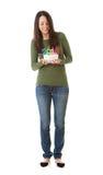 NYE :看下来2015生日蛋糕的妇女 免版税库存图片