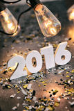 NYE: Filtered 2016 For The New Year With Antique Lights Above. Grungy, steampunk type background images for New Year's Eve 2016 Stock Photos