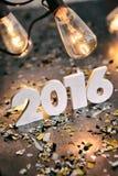 NYE: Filtrado 2016 por el Año Nuevo con las luces antiguas arriba Fotos de archivo