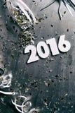 NYE : Fond 2016 sale avec des confettis et des flammes Photographie stock libre de droits