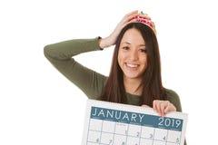 NYE: Frau hält an zu Tiara And Ready To Celebrate 2019 lizenzfreie stockfotografie