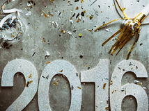 NYE: Glitter 2016 With Confetti And Party Horn. Grungy, steampunk type background images for New Year's Eve 2016 Stock Photography