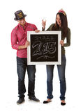 NYE: O par comemora o ano novo com contagem regressiva e Champagne Foto de Stock Royalty Free