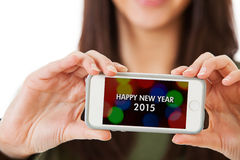NYE: Woman Holding Cell Phone With Happy New Year Message Stock Image