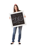 NYE: Woman Holds Up Chalkboard To Celebrate 2015 Royalty Free Stock Image
