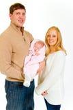 Nyfött behandla som ett barn och familjen Arkivfoto