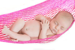 Nyfött behandla som ett barn sovande arkivfoton