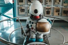 Nyfiken det dekorativa teckenet för astronaut royaltyfria bilder