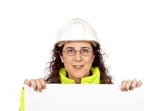 nyfiken kvinnligarbetare för konstruktion Arkivfoton