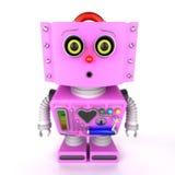 Nyfiken rosa leksakrobotflicka som ser in i kamera Royaltyfri Bild