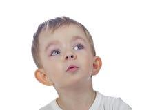 Nyfiket gulligt gyckel behandla som ett barn pojken Arkivbilder