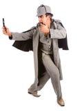Nyfikna Sherlock Holmes leda i rör och förstoringsglaset Royaltyfri Bild