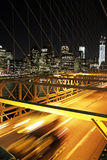 Speed and traffic in the Brooklin bridge, New York. Nyght traffic in the brooklyn bridge with a skyline of New York Royalty Free Stock Image