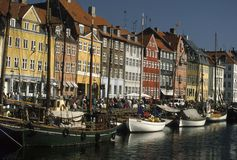 Nyhaven boats. And colorful buildings along a canal,Copenhagen,Denmark Stock Photos