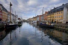 Nyhavn channel, in Copenhagen. Denmark. In a cloudy day Stock Photos