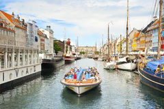 Nyhavn. COPENHAGEN, DENMARK - JULY 2: Canal tour in Nyhavn on July 2, 2014 in Copenhagen royalty free stock images