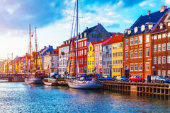 Nyhavn, Copenhagen, Denmark. Scenic summer sunset view of Nyhavn pier with color buildings, ships, yachts and other boats in the Old Town of Copenhagen, Denmark stock image