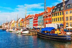 Nyhavn, Copenhagen, Denmark. Scenic summer view of Nyhavn pier with color buildings, ships, yachts and other boats in the Old Town of Copenhagen, Denmark Royalty Free Stock Image
