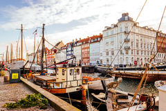Nyhavn district is one of the most famous landmarks in Copenhagen with typical colorful houses and water canals Stock Photo