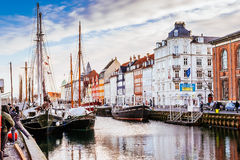 Nyhavn district is one of the most famous landmarks in Copenhagen with typical colorful houses and water canals Stock Image