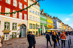 Nyhavn district is one of the most famous landmarks in Copenhagen with typical colorful houses and water canals Royalty Free Stock Photography