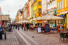 Nyhavn district is one of the most famous landmarks in Copenhagen with typical colorful houses and water canals Royalty Free Stock Photo