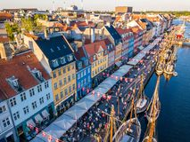 Nyhavn New Harbour canal and entertainment district in Copenhagen, Denmark. The canal harbours many historical wooden. Ships. Aerial view from the top Stock Image