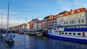 Nyhavn waterfront, canal and entertainment district with colorful houses, buildings, ships, yachts and boats in Old Town of stock image