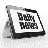 Nyheternabegrepp: Minnestavladator med daglig nyheterna på skärm Arkivfoto