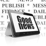 Nyheternabegrepp: Minnestavladator med goda nyheter på skärm Royaltyfri Bild